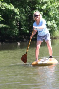 Our CEO Rebecca loves to paddle board during the warmer months!