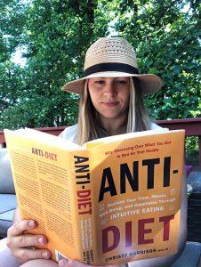 Kaitlin Eckstein reading diet culture book