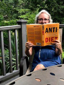 Rebecca Bitzer reading diet culture book